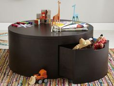 a coffee/play table with toy storage