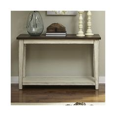 <p>A stylish stage in any space, the Lexie Console Table is the perfect foundation for your curated display.</p><p>Crafted of solid wood, it features a 2 tone finish with weathered details. The design is completed with a plank top, while an open lower shelf adds much-needed extra storage space.</p><p>Try adding a few intricate candle sticks and a vase of freshly-picked blooms for an elegant entryway anchor, or simply set down a single antiqued clock for...