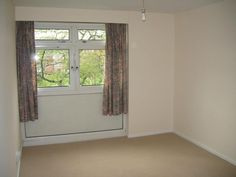 Simple cream walls and neutral carpet enhance the sense of space in the living room. http://www.ppmsltd.co.uk