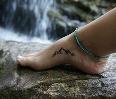 mountain foot tattoo