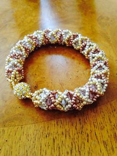 This bracelet has been a big hit with my customers!! ;). It is woven with 3 colors of metallic Toho glass seed beads and 3 coordinating colors
