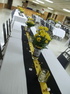 table arrangements for the class reunion, we mod-podged copies of yearbook pages onto vases