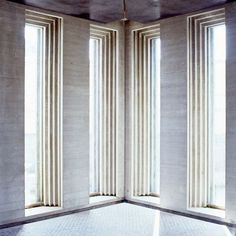 Tall windows with ribbed frames set in the wall