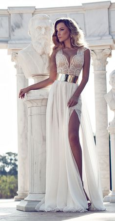 We're blown away by these amazing beach wedding dresses from top-notch designers…
