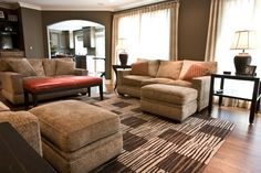 warm hues of brown and taupe saturate this transitional living room a