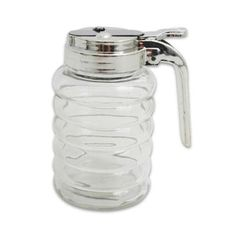 "4.75""H Classic Look Glass Beehive Syrup Dispenser Breakfast Dinner by OTC. $3.99. Measures approx. 4.75"".; Glass ribbed body.; Holds approximately 6 ounces.. This  syrup dispenser is just like the one you use at your local pancake house or diner. Made of solid glass with a metal lid, this dispenser hold apporx. 6-ounces of syrup, milk, cream, or sugar. The lid has a rubber gasket and thumb-operated, spring-loaded lever mechanism to prevent sticky spills and leakage...."