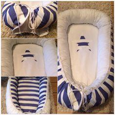 Mina egensydda babynest / sovpöl / snugglenest. Blåvitrandigt med vit bomull i mitten. Och stor blåvit stjärna i mitten. Kan göras på beställning i andra färger och tygmönster. Gå in på Facebook och sök upp gruppen Sylvie's Babynest för mer info och bilder! :)