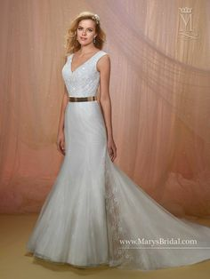 Tulle and lace side slit fit and flare/mermaid style bridal gown with V-neck, V-back, beaded bodice, gold metal belt, and semi-cathedral train.