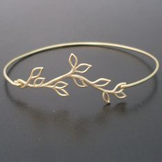 A gold plated olive vine with delicate open leaves has been transformed into an elegant olive branch bangle bracelet with a 14k gold filled band $24.95 X Small: 2.25 inches in Diameter (or 7.5 inch Circumference)