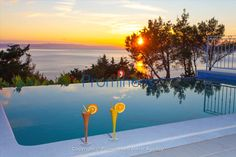 Holiday home Finestra Tučepi Croatia with infinity pool. What an amazing sunset... Cocktails by the pool is a great idea