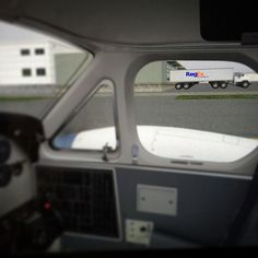 """BAHAHAHA!! Landed King Air at (no clue) airport in #xplane10 and found #nerdhumor: Looks like FedEx trucks but is actually """"RegEx"""" trucks with slogan """"We  can find it!"""""""