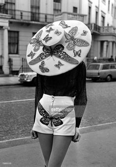 London, England, 6th April 1971, A model displays a Butterfly blouse, shorts and a hat as part of designer Simone Mirman+s Spring and Summer collection