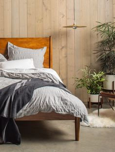 The Limited Edition Heathered Stripe Duvet Set and Blanket Weight Cashmere Throw in Charcoal.