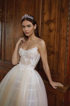 This strapless ball gown serves up elegant drama with hand-embroidered petals on the corset top and a tulip petticoat constructed of two-toned pleated silk tulle. The low scoop-neck silhouette and soft blush color palette add a dreamy quality that's both refined and romantic