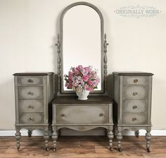 Painted in Annie Sloan Chalk Paint. It is French Linen with a halo dry brush of a graphite/french linen mix, followed by a dry brush of a metallic paint in champagne. Then clear wax and heavily dark waxed in the same halo fashion. By Originally Worn