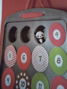 """""""With it's 24 openings, a mini-muffin pan makes a perfect base for a treat-filled Advent calendar. Because the numbered coverings are held on by magnets, you'll be able to bake with the pan again after Christmas."""" Family Fun Magazine November 2012 Issue Pg. 14"""