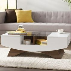 Wade Logan Madilynn Coffee Table with Storage Color: White Coffee Table With Storage, Lift Top Coffee Table, Coffee Tables, Bar Mobile, Floating Entertainment Center, Floating Tv Stand, Breakfast Nook Dining Set, Wall Mount Electric Fireplace, Coffee Table Wayfair