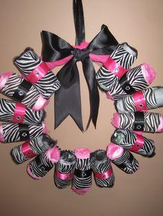 Zebra print diaper wreath. See more Zebra Baby Shower inspiration:http://www.squidoo.com/zebra-theme-baby-shower