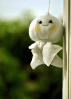 "Teru teru bōzu (literally means ""shine shine monk"") is a Japanese traditional hand-made doll, made of white paper or cloth and hanging outside of the window by a string. This amulet is supposed to have magical powers to bring good weather and to stop or prevent a rainy day."