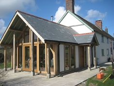 Google Image Result for http://www.tamarjoinerycompany.co.uk/timber-framed-house-extension-garden-room-conservatory-green-oak-french-doors.jpg