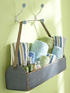 Hooked on Storage     Make use of extra wall space. Hang a box with a strong leather strap from two hooks and fill with rolled towels and toiletries.