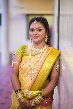Traditional Indian bride wearing bridal hair, saree and jewellery. Reception look. Makeup by Swank Studio. Find us at https://www.facebook.com/SwankStudioBangalore