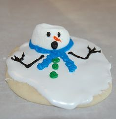snowman cookies...reg cookies...thin white icing, marshmallow (barely warmed) as the head