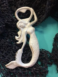 """The White Mermaid Cast Iron Bottle Opener will be so fun at your next party! This bottle opener is around 7"""" If this product is out of stock it may take up to 3-4 weeks to be shipped."""