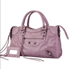 NWT/by Style/Me/LG TOTE W SHOULDER STRAP/Lavender NWT/StyleMe/Large Tote/detachable Shoulder strap/Pale Rose/lavender/color w silver hardware/beautiful bag but I think it's a bit small for all my stuff/still on the edge/Very Nice Quality Bag!**COLOR IN 1st & last pics are bag for sale others/show/attachments/inside  2 Rolled/Braided Handles Top zip close Adjustable/removable shoulder strap Front zip pocket Interior black cloth w slip & zip pockets Textured PU leather…
