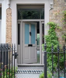 What do you think of this 'Charleston Gray' color paired with the brick of this home? It makes for a warm and welcoming entrance :) Grey Front Doors, Painted Front Doors, Front Door Colors, Charleston Grey Farrow And Ball, Free Wallpaper Samples, Oval Room Blue, Eco Friendly Paint, Metallic Wallpaper, Bank Holiday Weekend