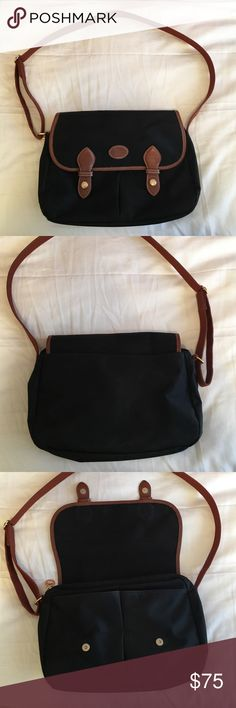 """Longchamp Cross Body Bag Black lightweight nylon material, brown leather trim, gold hardware, gently used. Dimensions: 12""""L x 3""""W x 8""""H. Adjustable strap. Longchamp Bags Crossbody Bags"""