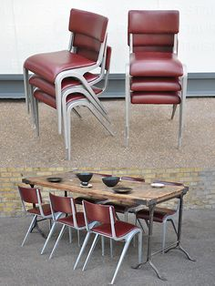 Set of 6 esavian aluminium framed chairs. This set re-upholstered in red leather.  created by: James Leonard for Esavian  origin: UK  year: 1950