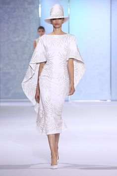 White silk crêpe kaftan dress, embellished with glass beads and silver feather thread-work.
