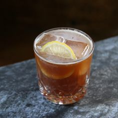 Cognac-Walnut Sour 1.5 ounces of Cognac (Courvoisier VSOP) 1 ounce of walnut liqueur 3/4 ounce of lemon juice 1/4 ounce of simple syrup dash of Angostura bitters Garnish with a thin lemon wheel