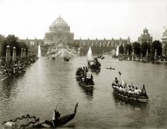 "Floral Parade of All Nations procession on the Grand Lagoon in front of Festival Hall during the 1904 World's Fair. (Gondola with sign ""Visit Asia"")."