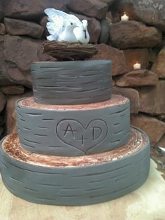 My cake!! Turned out a little more grey than I wanted, but it looked amazing nonetheless, and tasted better!! So proud of my cake topper, made it myself! <3