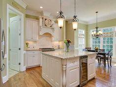 I am thinking light kitchen next time.  Like these antique whites :)