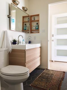 West Elm - California Retro Beach House Makeover // mod bathroom, hex floor, light wood floating vanity