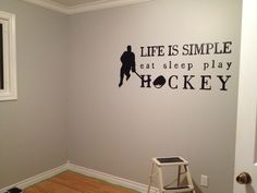 Our hockey theme bedroom hand painted wall art :)