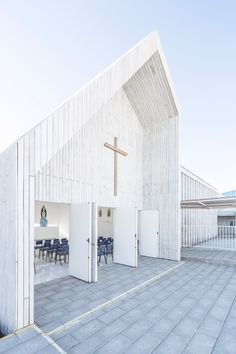 A school that was destroyed during the 2010 Chile earthquake has been rebuilt using simple white-painted pine.