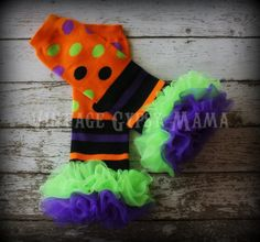 Hey, I found this really awesome Etsy listing at http://www.etsy.com/listing/107630599/halloween-stripes-and-polka-dot-leg
