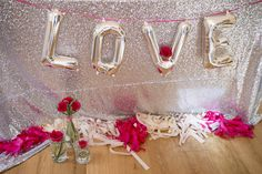 Silver and pink Valentine's Day party. LOVE balloons. See more on www.prettymyparty.com.