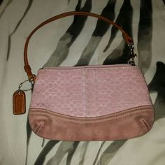 Coach Wrislet This has been used as you can see, never tried to clean it ( don't know how). Still in good condition.  Pastel pink color. Price reflects the use. Coach Bags Clutches & Wristlets