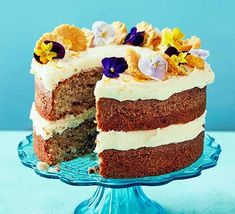 This showstopping celebration cake tastes of summer, with pineapple and banana flavours, tangy cream cheese frosting and delicate edible flowers Cake Recipes Bbc, Bbc Good Food Recipes, Baking Recipes, Flour Recipes, Bread Recipes, Dinner Recipes, Turnip Cake, Bbc Good Food Show, Hummingbird Cake