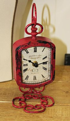 This vintage style table top clock is inspired by a Paris antique. Will bring a touch of French cottage charm to your home. Metal Clock in distressed antiqued fuchsia red finish