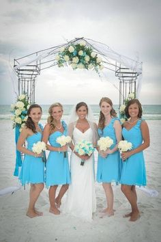 I love the blue color of the bridesmaid dresses and the wedding dress!!! <3