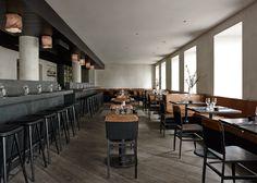 Simple materials shape Space Copenhagen restaurant interior