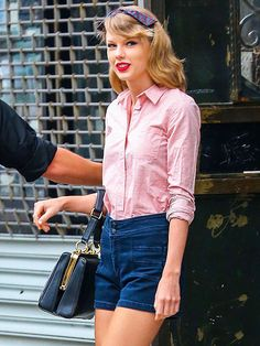 Star Tracks: Friday, May 16, 2014 | THINK PINK | Flawless, even after a workout! Taylor Swift rocks a retro look in a button-down blouse and high-waisted denim shorts on her way out of the gym, Thursday in New York City.