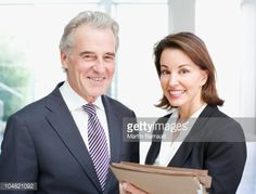 Foto de stock : Smiling business people holding files in office