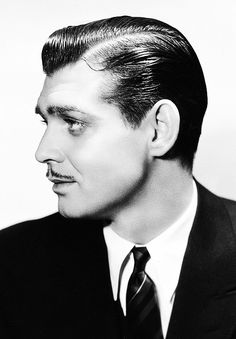 Clark Gable's jaw line is not too sharp but still has angular lines. Heavy shadow